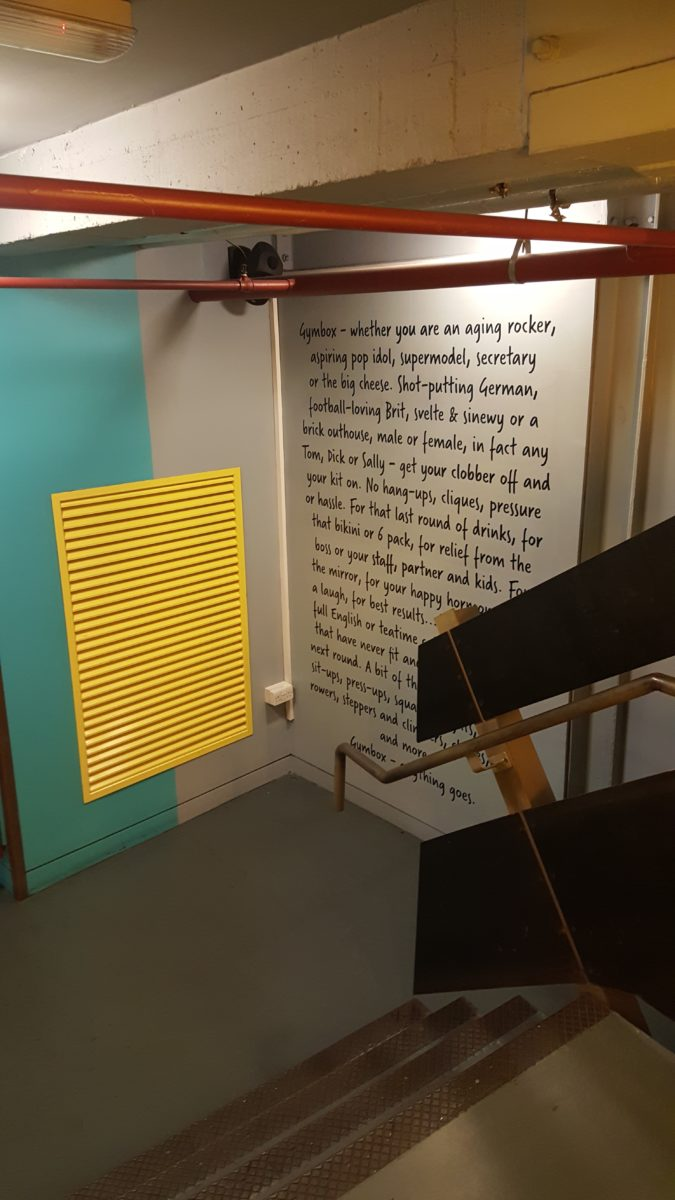 Sign writing quotes written on an internal wall for Gymbox by Traditional Signs of London