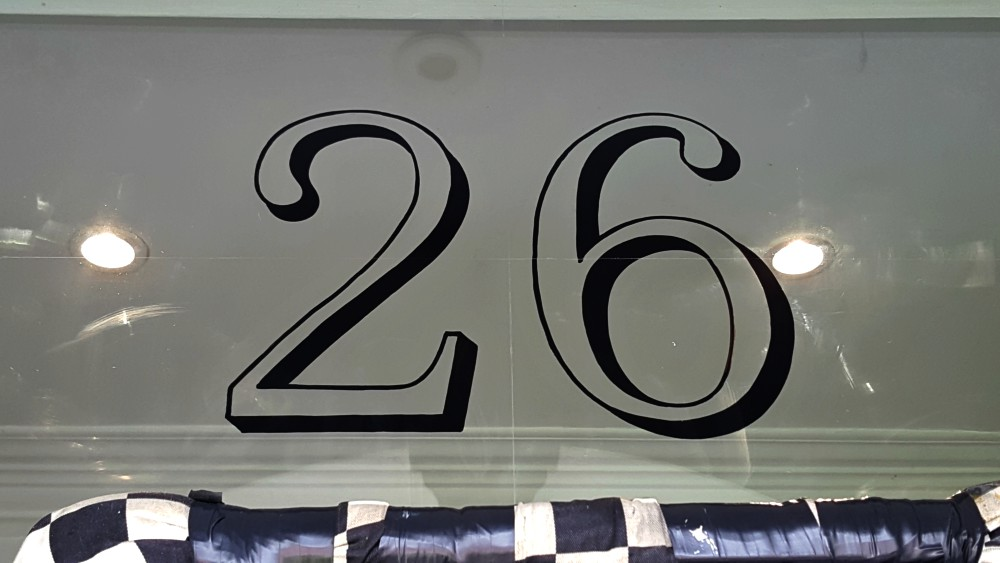 Property number signwriting by traditional signs of London